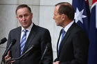 John Key says New Zealand totally respects the sovereign right of Tony Abbott's Government to make decisions on how to treat people who work in Australia. Photo / AP