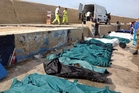 Bodies of some of the drowned African migrants were lined up in the port of Lampedusa yesterday. Photo / AP