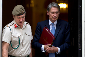 Britain's Defence Secretary Philip Hammond, right. Photo / AP