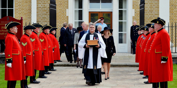 Margaret Thatcher's ashes are carried from the Royal Hospital Chelsea for interment in the grounds. Photo / AP