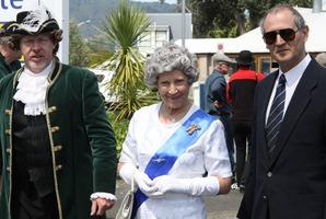 The town crier, the Queen and the Queen's bodyguard at Brits at the Beach in Tairua.