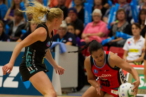 Bessie Manu (right) in action for the Canterbury Tactix in this year's ANZ Championships. Manu is the latest signing for the Kia Magic for next year. Photo / Alan Gibson