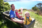Kane Fannin and children Indie, 3, and Albie, 5, at Whale Bay, mum Nadia's favourite beach. Photo / APN