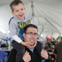Daniel Pickford gets a ride with dad Brett Pickford at the Artisans Fair on the Town Basin Canopy Bridge. Photo / Ron Burgin