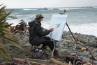 Robert Long paints near his remote home at Gorge River.