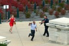People run for cover as police converge on Capitol Hill in Washington, DC. Photo / AFP
