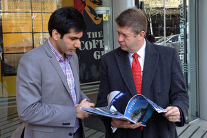 Labour leader David Cunliffe, right, meets first home buyer Kanik Mongia. Photo / Brendan Manning