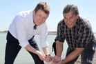 Labour Party leader David Cunliffe and Ngati Kahungunu Iwi Inc chairman Ngahiwi Tomoana check out whitebait in the Tukituki River. Photo / Duncan Brown