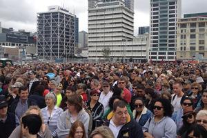 Thousands wait to welcome home Team NZ. Photo / Greg Bowker