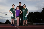 Bellvue Athletics Club treasurer Penny Lloyd and her daughter Lucy, with Hamish and Patrick McDrury, show just how far the club's uniforms have come in 50 years. Photo / Joel Ford