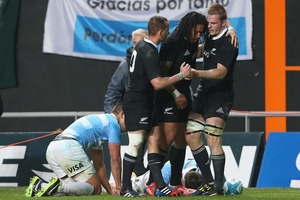 Sam Cane, right,  is congratulated by  Ma'a Nonu and Aaron Cruden after scoring the second try  against Argentina yesterday. Photo / Getty Images