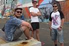 Street artists Cinzah Merkens (aka Seekayem, left), Misha Uteev (Wert 159) and Simon Ormerod (Cracked Ink) during their transformation of the Kaikohe Hotel. Photo / Peter de Graaf