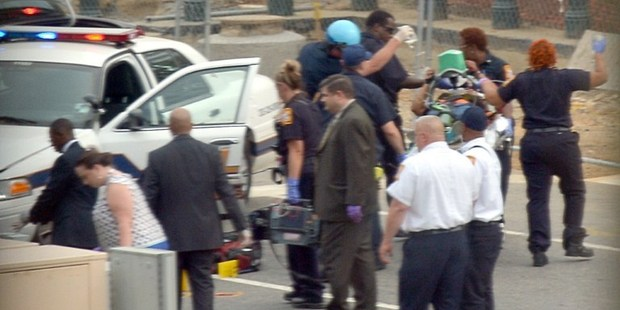 Capitol Hill police and medics take a shooting victim away on a stretcher. Photo / AFP