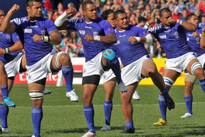Samoan players perform the  siva tau during the 2011 Rugby World Cup. Photo / Alan Gibson