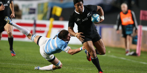Julian Savea of the All Blacks breaks clear of Julio Farias Cabello and heads for the tryline during today's match. Photo / Getty Images