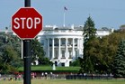The White House is seen behind a stop sign in Washington, DC, as the federal shutdown began. Photo / AFP