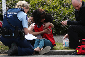 A boy is comforted after being hit by a car on Chadwick Road. Photo: Joel Ford