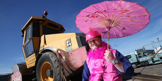 Pink feathers and stack-hats are all part of a day's work for Fulton Hogan traffic management manager Paul Tyson, in the lead-up to the HOT (House of Travel) Pink Walk. Photo / Joel Ford