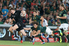 Beuden Barrett of the All Blacks breaks clear to score the bonus point winning fourth try during the Rugby Championship. Photo / Getty Images