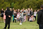 Louis Tomlinson shows off his soccer skills in an impromptu game in Christchurch to adoring fans - Directioners.