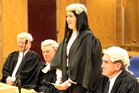 Zoe Johnston was admitted to the bar at the Napier High Court last month with the support of family friends, Graham Throp (left) and Bill Calver and her father, Quentin Johnston, who are all lawyers. Photo / Paul Taylor