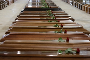 Coffins for some of the 111 bodies recovered so far. Photo / AP