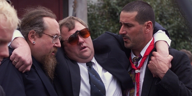 Mark Lundy is supported by friends at the funeral of his wife and daughter. He was arrested months later.