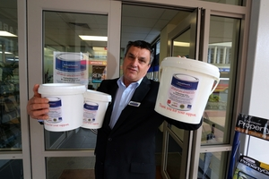 BUCKETLOADS OF HELP: Martin Dear, manager of Barfoot & Thompson Whangarei, is urging people to get behind next Saturday's Can and Coin Collection. PHOTO/JOHN STONE