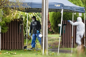 SEEKING ANSWERS: Police staff check the scene after Wiremu Birch was killed yesterday. PHOTOS/STEPHEN PARKER 111013SP1