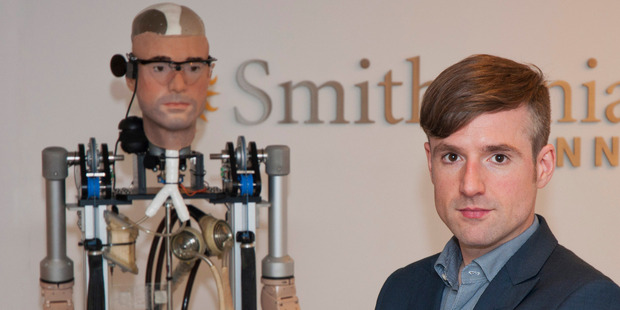 Bertolt Meyer, a social psychologist for the University of Zurich, poses next to the real life bionic man. Photo / AP