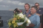 Fishermen on the Italian island of Lampedusa lay flowers at sea in a moving homage to victims of a shipwreck tragedy that left about 300 African migrants feared dead.