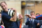 Britain's Prince William takes part in a football training session in the garden of Buckingham Palace. Photo / AFP