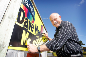 Dave Macpherson plasters over his signs 'Dave Mac for Mayor' with 'Dave Mac for Council' now he is asking supporters to vote for one of his rivals in the mayoralty. Photo / APN