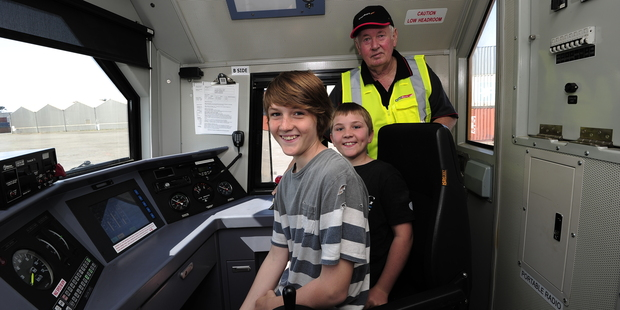 Enthusiasts Liam Andrews, 12, (left) and Ethan Andrews, 9, tested out the new DL Locomotive with Bryan Campbell of Mount Maunganui, one of KiwiRail's longest-serving drivers. Photo / George Novak