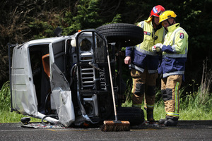 Firefighters had to free a woman trapped in the 4WD. Photo / Joel Ford