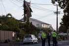 The remains of roofing iron hanging from powerlines on Vauxhall Road, Devonport, after the storm. Photo / Brett Phibbs