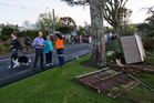 Devonport residents talk with local board member Chris Darby as they inspect the damage. Photo / Brett Phibbs