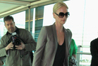 Charlize Theron's airport arrival style: no suitcases, no iPad, no makeup bag, no bottle of water.  Photo / Getty Images