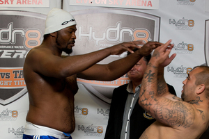 Julius Long pushes Jason Williams during the weigh in for their boxing bout. Photo / Brett Phibbs