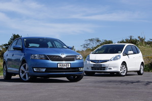 The Skoda Rapid (front) lines up well against Honda's hybrid model Jazz. Pictures / David Linklater