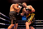 Joseph Parker (Yellow) in action during his fight with Afa Tatupu. Photo / Dean Purcell