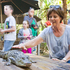 Judy Bailey has a close encounter with a baby crocodile during the Bush Tucker breakfast. Photo / Greg Bowker