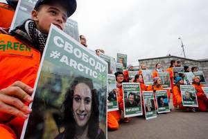 Greenpeace activists hold up portraits of the seized crew members of the ship Arctic Sunrise, in a rally in Moscow. Photo / AP