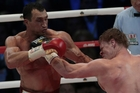 Heavyweight champion Wladimir Klitschko, of Ukraine, left, and Alexander Povetkin, of Russia, hit each other during their bout at the Olympic Stadium, in Moscow. Photo / AP
