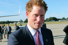 Britain's Prince Harry speaks to the media at Sydney Airport before departing for Perth. Photo / AP