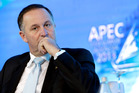 Prime Minister John Key listens to a moderator at the Asia-Pacific Economic Cooperation CEO Summit in Bali. Photo / AP