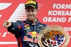 Red Bull driver Sebastian Vettel gestures as he celebrates on the podium after winning the Korean Formula One Grand Prix at the Korean International Circuit in Yeongam, South Korea. Photo/AP