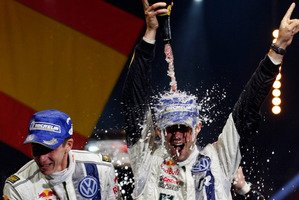 Sebastien Ogier, right, and co-driver Julien Ingrassia, both from France, celebrate their win in the Rallye de France and in their world champions title in Strasbourg. Photo / AP