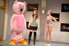 Bobby Moynihan, Vanessa Bayer and guest host Miley Cyrus in a scene during Saturday Night Live.