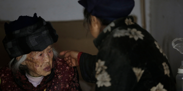 Zhang Zefang, a 94-year old woman who sued her own children for not taking care of her, left, and Kuang Shiying, Zhang's daughter-in-law. Photo / AP